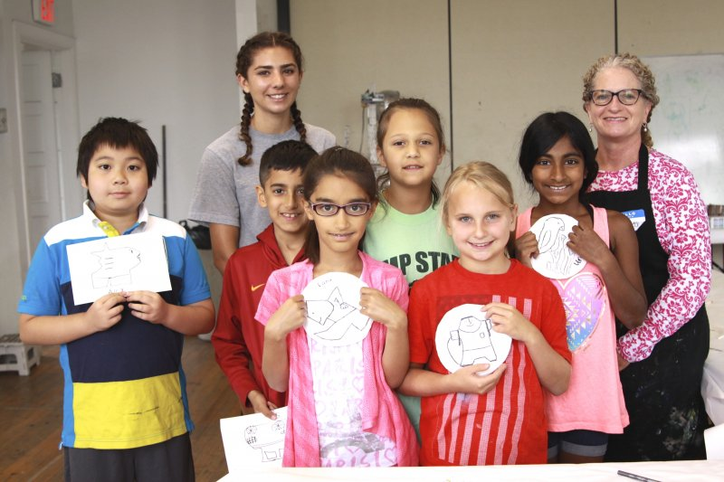 A group of summer campers with their teacher