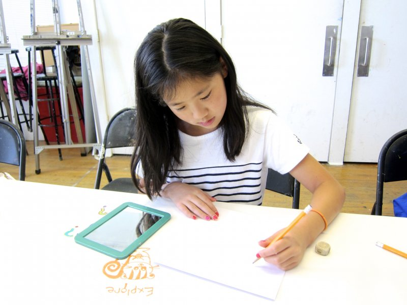 Summer camper drawing a self portrait