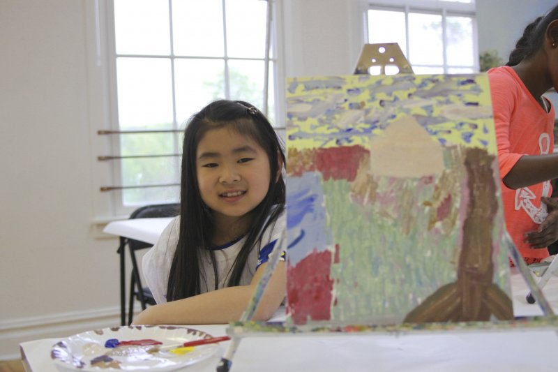 Summer camper with her painting