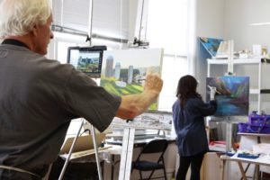 Adult students painting in an oil painting class at The Center