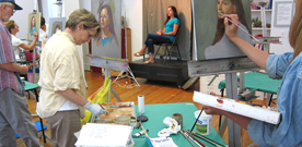 Photo of adult students in a portrait painting class